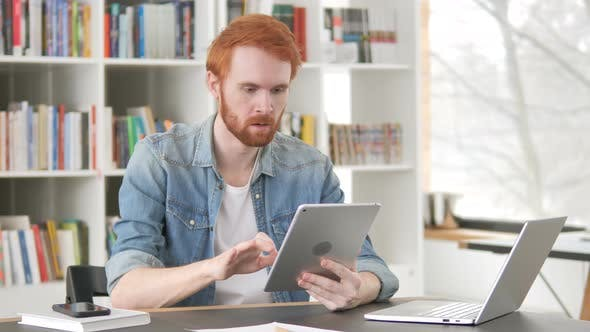 Thumbnail for Upset Casual Redhead Man Facing Loss on Tablet