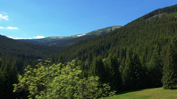 Thumbnail for Landscape with Mountains with Forests in Summer Sunny Day - Aerial Moving Shot