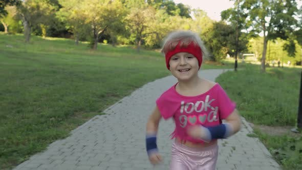 Thumbnail for Little Caucasian Runner Child Girl in Pink Sportswear Running Outdoors in Park. Workout for Kids
