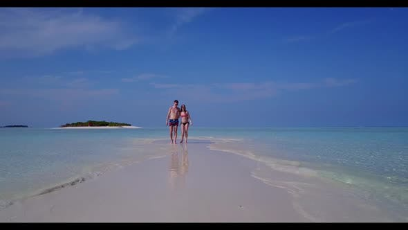 Thumbnail for Romantic couple tanning on tropical seashore beach adventure by aqua blue sea with white sandy backg