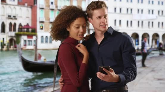 Thumbnail for Millennial couple use app on smartphone for directions in Venice