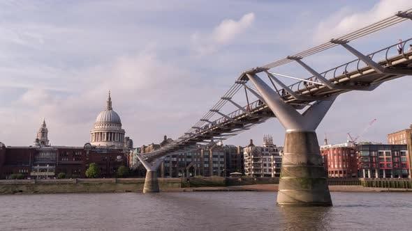 Millenium bridge london river thames skyscapers people commute