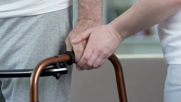 Thumbnail for Man Trying to Walk with Frame, Wife Supporting Recovering Husband, Love and Care