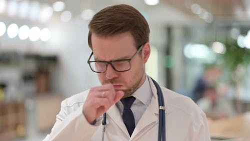 Portrait of Allergic Male Doctor Coughing