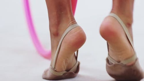Little Girl's Feet at Gymnastics Training in the Gym