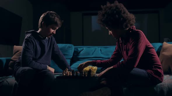 Thumbnail for Diverse Teen Boys Moving Pieces on Chess Board