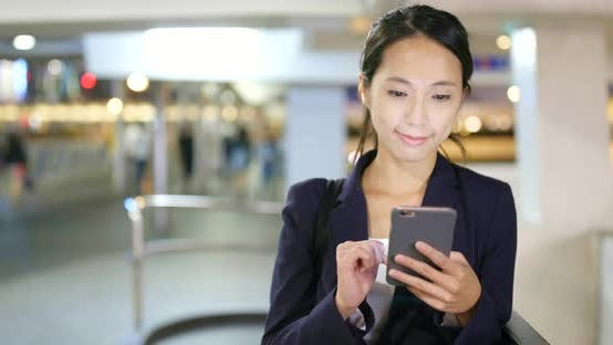 Thumbnail for Businesswoman use of cellphone in Hong Kong city