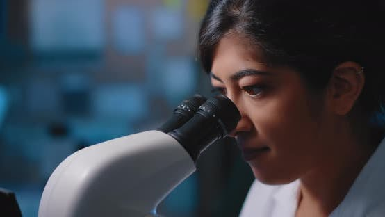 Thumbnail for Female Research Scientist Looking at Samples Under Microscope