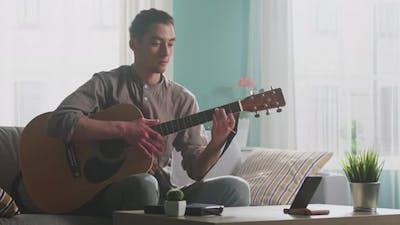 Man Musician Is Communicating Online
