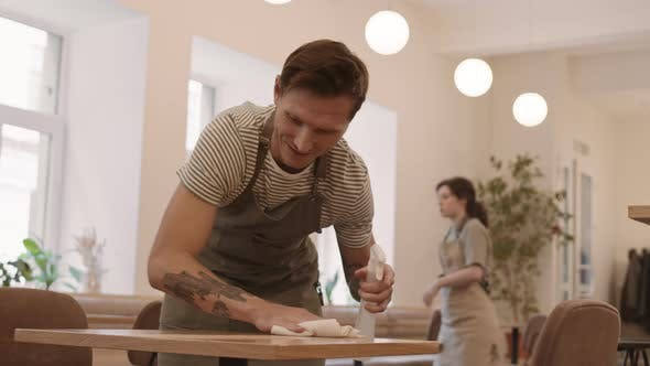Thumbnail for Male Cafe Worker Wiping Table