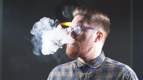 Brutal Handsome Ginger Man Is Smoking Hookah in the Bar