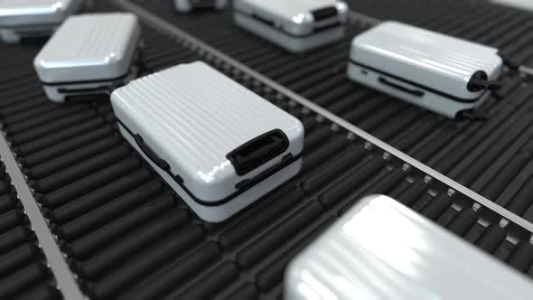 Thumbnail for White Suitcases Move Along Conveyor in Airport