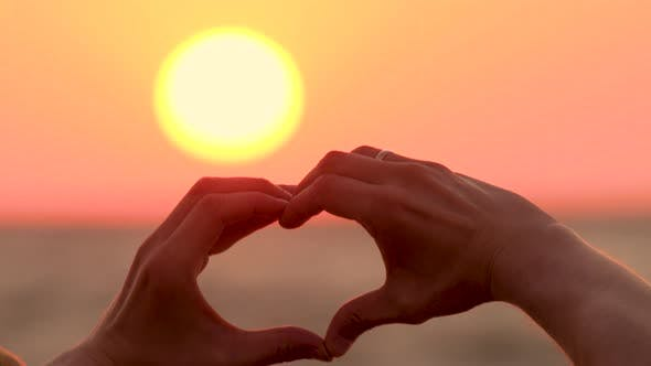 Thumbnail for Symbol of Love, Feelings. New Beginning. Morning Summer Sun and Heart Made By Hands. Closeup of