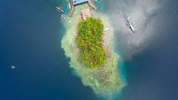 Thumbnail for Aerial Top View Boat Pier in a Beautiful Tropical Bay on Sugba Lagoon in Siargao, Philippines.