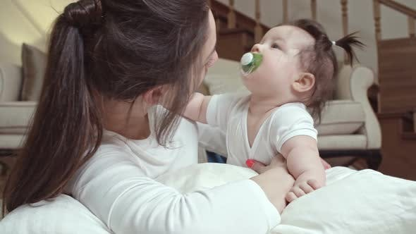 Cover Image for Mother Kissing Baby with Soother