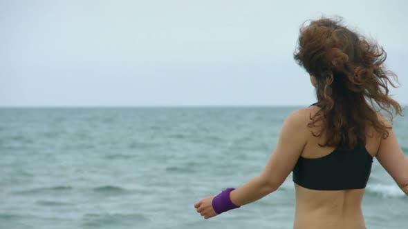 Thumbnail for Active Young Woman Stops to Look at Amazing Seascape. Salty Sea Waves Splashing