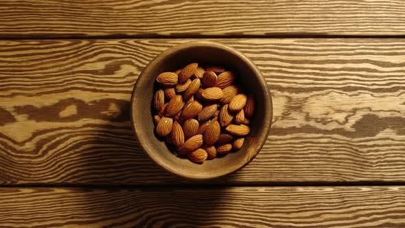 Thumbnail for Peeled Almonds Appear In Wooden Cup And Full This Cup