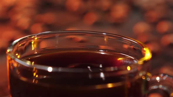 Thumbnail for Cup with a Coffee Drink Which Drips Drop. Slow Motion
