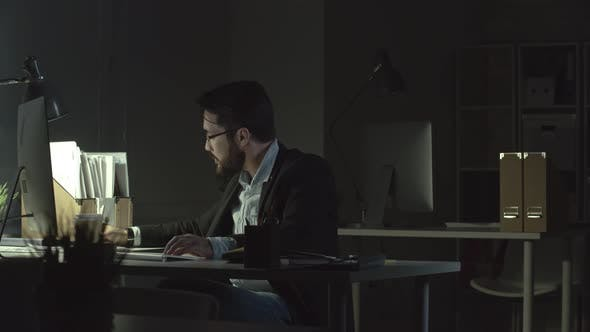 Thumbnail for Man Working in the Office at Night