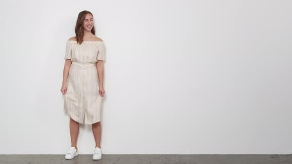 Thumbnail for Woman in White Buttoned Down off-shoulder Dress Spins Playfully