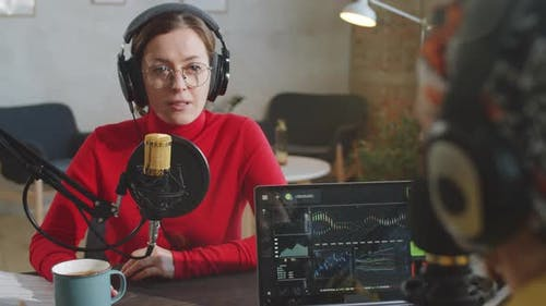 Woman Giving Interview to Podcast Presenter in Studio