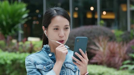 Thumbnail for Woman chat on the earphone at outdoor