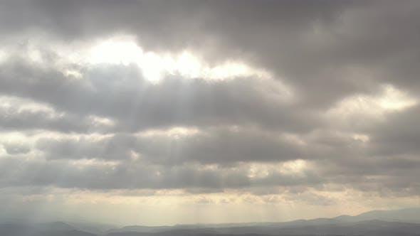 Rays of sun through the cloudy sky 4K drone footage