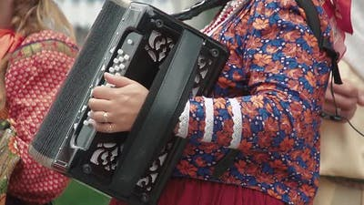 Woman Dressed in a Folk Costume Plays the Accordion 2