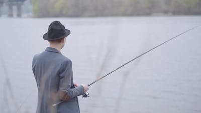 Fisherman in a Jacket and a Cap with a Brim Young Fisherman in a Jacket and a Cap with a Brim