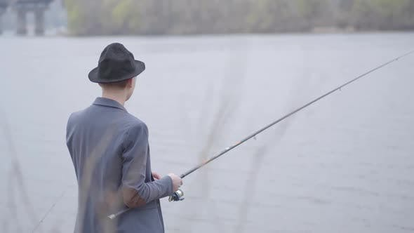 Thumbnail for Fisherman in a Jacket and a Cap with a Brim Young Fisherman in a Jacket and a Cap with a Brim