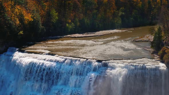 Thumbnail for Waterfall at Genesee River with Banks Covered with Autumn Forest