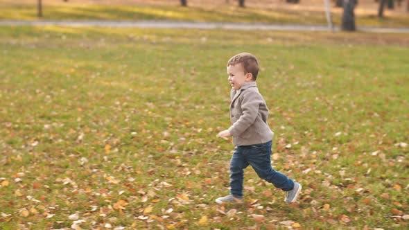 Happy Boy Runs to His Mother
