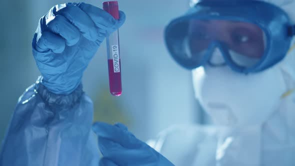 Thumbnail for Scientist Examining Blood in Test Tube with Covid-19 Inscription