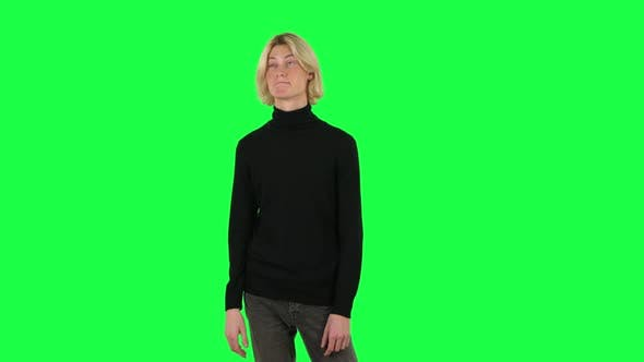 Cover Image for Blonde Guy Negatively Waving His Head and Smiling. Green Screen
