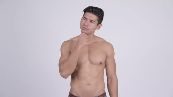 Thumbnail for Young Handsome Muscular Shirtless Man Thinking and Looking Up