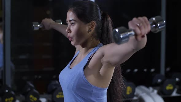 Thumbnail for Woman Doing Exercises with Dumbbells