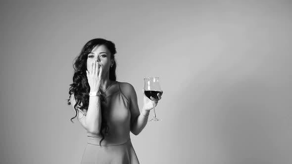 Thumbnail for Stunning Elegant Girl Dancing with Glass of Wine in Studio