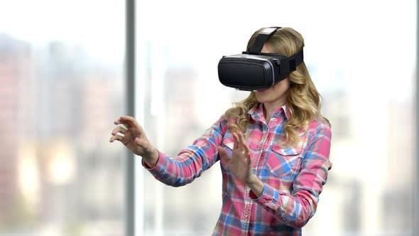 Happy Girl Wearing Virtual Reality Glasses.