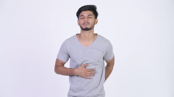 Thumbnail for Young Stressed Bearded Indian Man Having Stomach Ache