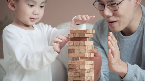 Thumbnail for Happy asian family playing game jenga together.
