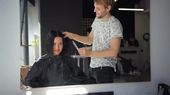 Happy Young Brunette Woman and Hairdresser Preparing for Haircut or Hairstyle at Beaty Salon