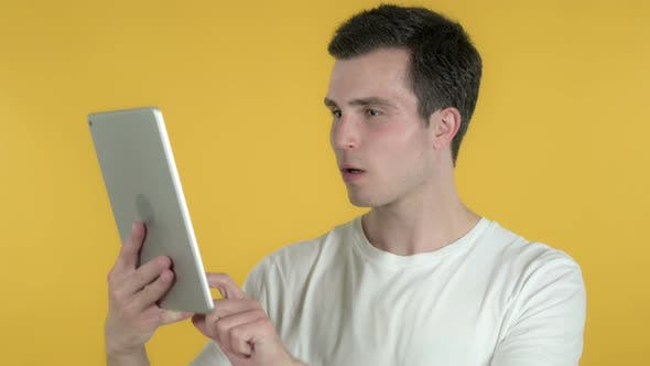 Thumbnail for Man Reacting To Loss on Tablet, Yellow Background