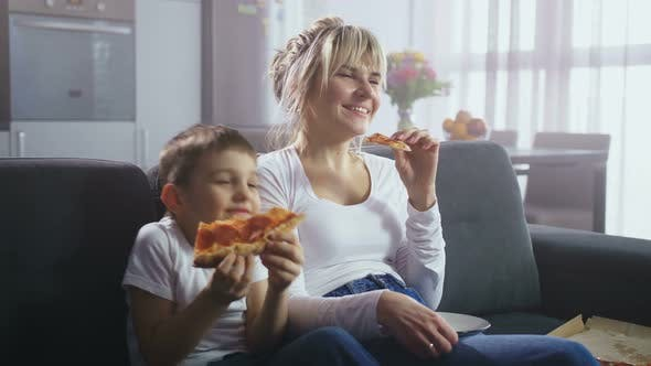 Thumbnail for Family Watching Comic TV Show and Eating Pizza