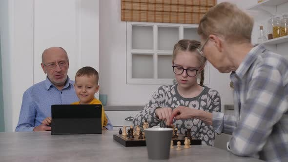 Thumbnail for Grandma Playing Chess with Granddaughter at Home