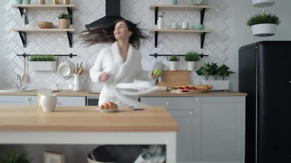 Thumbnail for Girl Dancing in Kitchen