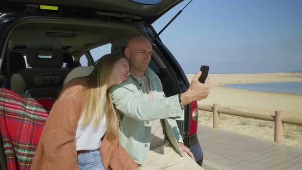 Thumbnail for Couple Photographing with Smartphone in Car