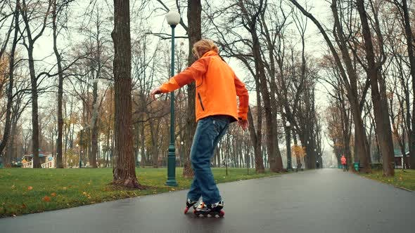 Thumbnail for Close-up View of a Skating Bearded Professional Male Roller Skater Performing Complex Technical