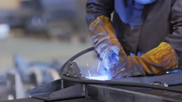 Thumbnail for Factory Laborer Welding with Gas Torch