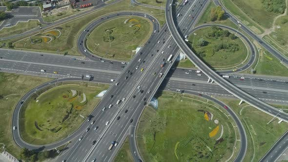 Cover Image for Complex Road Junction and Cars Traffic in Sunny Summer Day. Aerial View