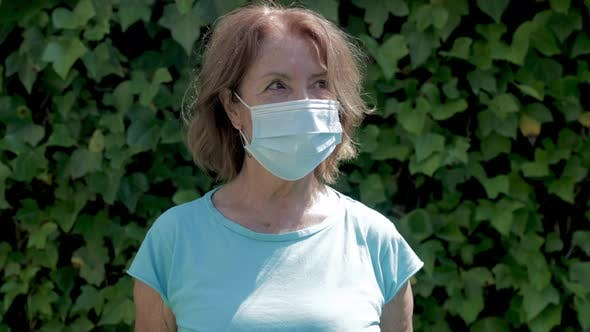 Mature Woman Wearing Protective Face Mask